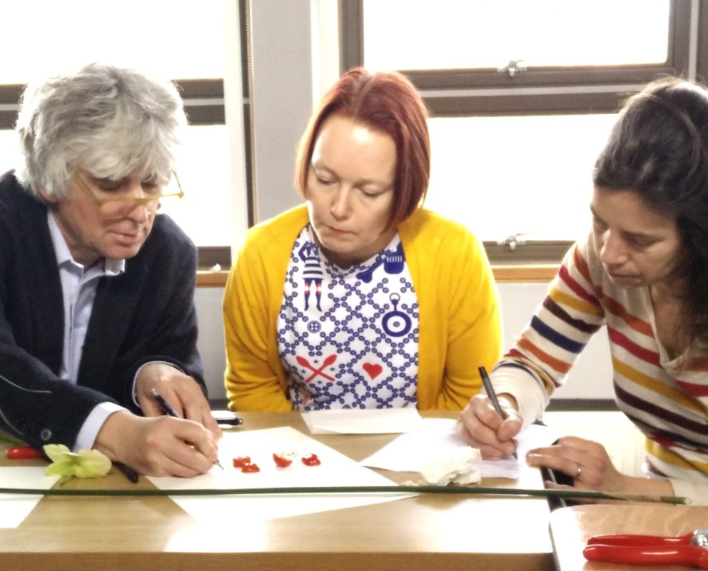 IUCN Director of the World Heritage Programme, Tim Badman, Heritage Futures artist, Pernilla Frid, and co-investigator Caitlin Desilvey hard at work pressing tomatoes at at the Kew Gardens Diversity knowledge exchange.